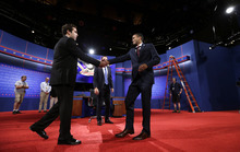 Lynn University students A.J. Mercincavage, stand-in for Republican presidential candidate former Massachusetts Gov. Mitt Romney, left, and Eric Gooden, stand-in for President Barack Obama, right, shake hands on stage during testing for Monday's presidential debate, Sunday, Oct. 21, 2012, at Lynn University in Boca Raton, Fla. (AP Photo/Charlie Neibergall)