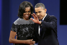 President Barack Obama with his wife Michelle waves to the audience after the third presidential debate at Lynn University, Monday, Oct. 22, 2012, in Boca Raton, Fla. (AP Photo/Charlie Neibergall)