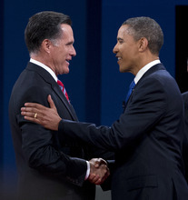 Republican presidential candidate, former Massachusetts Gov. Mitt Romney shakes hands with President Barack Obama before the start of the third presidential debate on Monday, Oct. 22, 2012, in Boca Raton, Fla.  (AP Photo/ Evan Vucci)