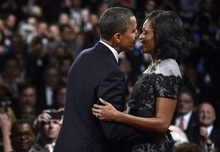 President Barack Obama and First lady Michelle Obama kiss after the third presidential debate at Lynn University, Monday, Oct. 22, 2012, in Boca Raton, Fla. (AP Photo/Pool-Michael Reynolds)