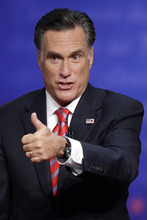 Republican presidential nominee Mitt Romney flashes a thumbs up to the audience after the third presidential debate at Lynn University, Monday, Oct. 22, 2012, in Boca Raton, Fla. (AP Photo/Charlie Neibergall)
