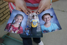 Scott Sommerdorf  |  The Salt Lake Tribune               Nina Neubert, of Orem, holds photos of her neices and nephew. Neubert says she was misled about the adoption process by DCFS, causing her to lose the opportunity to adopt the children from foster care due to a missed deadline. The children will likely now be adopted by a foster family. Photographed at her home in Orem, Friday, October 19, 2012.