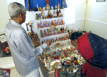 Al Hartmann  |  The Salt Lake Tribune Neale and Indra Neelameggham light a candle before prayers in front of their home altar to celebrate Navratri.   Hindus celebrate Navratri, a nine-day festival that is largely based in the home with friends and neighbors.