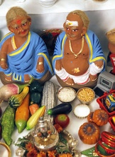 Al Hartmann  |  The Salt Lake Tribune Shopkeeper figures sit on the lowest step on Indra and Neale Neelameggham's Navratri altar.  The lowest step represents scenes from everyday life.   Hindus celebrate Navratri, a nine-day festival that is largely based in the home with friends and neighbors.