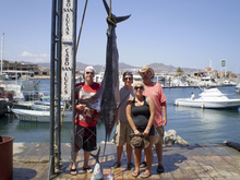 (Submitted by Brian Florida)  (left to right) Jarron Homer, Cameron Dayton, Krista Florida and Brian Florida stand next to one of the Marlin they caught while fishing in Cabo San Lucas on vacation. It is a Striped Marlin, which was 100 pounds, and 105 inches long. They also caught  three dolphin fish on the same outing. After all the measuring, photo's and casting for a mount, the meat was donated to a local orphanage.