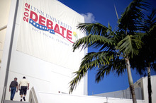 Workers enter the debate hall ahead of Monday's presidential debate between Republican presidential candidate and former Massachusetts Gov. Mitt Romney and President Barack Obama, Sunday, Oct. 21, 2012, at Lynn University in Boca Raton, Fla. (AP Photo/David Goldman)