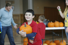 Scott Sommerdorf  |  The Salt Lake Tribune               Christian Flores, 6, beams after choosing his pumpkin as children at the Kauri Sue Hamilton School in Riverton got a special Halloween delivery from an unlikely source, Monday, Oct. 21, 2012. More than 3,500 pumpkins harvested, gathered, and cleaned by Utah State Prison inmates in the Utah State Prison's Greenhouse program were donated to various organizations that serve children in our community.