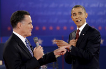 President Barack Obama, right, and Republican presidential candidate, former Massachusetts Gov. Mitt Romney exchange views during the second presidential debate Thursday, Oct. 18, 2012, at Hofstra University in Hempstead, N.Y. (AP Photo/David Goldman)