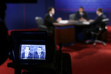 Lynn University students A.J. Mercincavage, stand-in for Republican presidential candidate former Massachusetts Gov. Mitt Romney, left, and Eric Gooden, stand-in for President Barack Obama, right, are seen on a television camera during testing for Monday's presidential debate, Sunday, Oct. 21, 2012, at Lynn University in Boca Raton, Fla. (AP Photo/Charlie Neibergall)