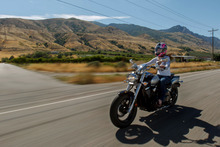 Trent Nelson  |  The Salt Lake Tribune Jen Comer joins a July motorcycle ride in Ogden to raise money for Weber County Sheriff Terry Thompson and Cache County Sheriff G. Lynn Nelson.