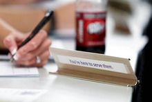 Trent Nelson  |  The Salt Lake Tribune A note on the back of Jen Comer's student senate name tag reads,
