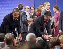 Republican presidential candidate, former Massachusetts Gov. Mitt Romney, right, and President Barack Obama, left, greet members of the audience at the end of the final debate at Lynn University, Monday, Oct. 22, 2012, in Boca Raton, Fla. (AP Photo/Pablo Martinez Monsivais)