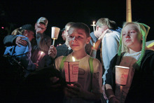 Family members of Autumn Pasquale participate in a candlelight vigil, Monday Oct. 22, 2012, in Clayton, N.J. About 200 law enforcement officials and hundreds more volunteers searched Monday for a southern New Jersey girl who disappeared over the weekend, raising anxiety in a rural town and pulling residents together. (AP Photo/Joseph Kaczmarek)