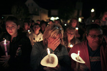 Members of the community participate in a candlelight vigil for Autumn Pasquale, Monday Oct. 22, 2012, in Clayton, N.J. About 200 law enforcement officials and hundreds more volunteers searched Monday for Autumn, a southern New Jersey girl who disappeared over the weekend, raising anxiety in a rural town and pulling residents together. (AP Photo/Joseph Kaczmarek)