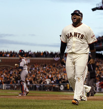San Francisco Giants' Pablo Sandoval reacts after scoring during the third inning of Game 7 of baseball's National League championship series against the St. Louis Cardinals Monday, Oct. 22, 2012, in San Francisco. (AP Photo/Ben Margot)