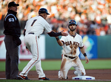 San Francisco Giants' Angel Pagan is safe after sliding into third base during the second inning of Game 7 of baseball's National League championship series against the St. Louis Cardinals, Monday, Oct. 22, 2012, in San Francisco. (AP Photo/The Sacramento Bee, Randy Pench)  MAGS OUT; LOCAL TV OUT (KCRA3, KXTV10, KOVR13, KUVS19, KMAZ31, KTXL40); MANDATORY CREDIT