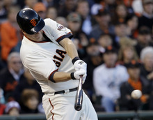 San Francisco Giants' Matt Cain hits an RBI single during the second inning of Game 7 of baseball's National League championship series against the St. Louis Cardinals Monday, Oct. 22, 2012, in San Francisco. (AP Photo/David J. Phillip)