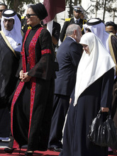 Qatar's First Lady Sheika Mozah bint Nasser al-Missned, left, and Amal Haniyeh, the wife of Gaza's prime minister Ismail Haniyeh, right, attend a welcome ceremony upon her arrival at the Rafah border crossing with Egypt, southern Gaza Strip, Tuesday, Oct. 23, 2012. The emir of Qatar entered the Gaza Strip on Tuesday, becoming the first head of state to visit the Palestinian territory since Islamist Hamas militants seized control there in 2007.(AP Photo/ Mohammed Abed, Pool)