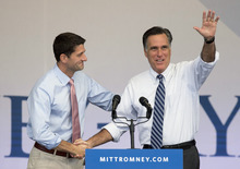 Republican presidential candidate former Massachusetts Gov. Mitt Romney, right, is greeted by running mate Rep. Paul Ryan, R-Wis., at the start of a rally, Tuesday, Oct. 23, 2012, in Henderson, Nev. Fresh off the presidential debate in Florida, Romney and Ryan were making their first joint appearance in Nevada before heading to Denver for another campaign stop. (AP Photo/Julie Jacobson)