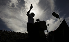 A silhouetted President Barack Obama gestures while speaking at a campaign event at Delray Beach Tennis Center, Tuesday, Oct. 23, 2012 in Delray Beach, Fla., the day after the last presidential debate against Republican Presidential candidate, former Massachusetts Gov. Mitt Romney. The president is making campaign stops in Florida and Ohio today. (AP Photo/Pablo Martinez Monsivais)