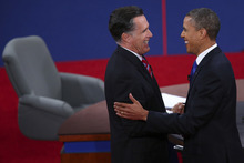 Republican presidential nominee Mitt Romney and President Barack Obama shake hands after the third presidential debate at Lynn University, Monday, Oct. 22, 2012, in Boca Raton, Fla. (AP Photo/Pool-Win McNamee)
