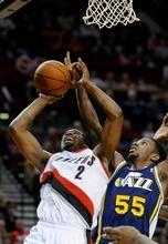 Portland Trail Blazers' Wesley Matthews (2) shoots against Utah Jazz's Kevin Murphy (55) during the second half of an NBA preseason basketball game in Portland, Ore., Monday, Oct., 22, 2012. The Trail Blazers beat the Jazz 120-114. (AP Photo/Greg Wahl-Stephens)