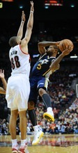 Utah Jazz's Mo Williams (5) looks to pass against Portland Trail Blazers' Nicolas Batum (88), of France, during the first half of an NBA preseason basketball game in Portland, Ore., Monday, Oct., 22, 2012. (AP Photo/Greg Wahl-Stephens)