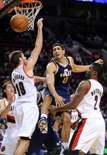 Utah Jazz's Enes Kanter (0) loses the ball against Portland Trail Blazers' Joel Freeland (18) and Wesley Matthews (2) during the first half of an NBA preseason basketball game in Portland, Ore., Monday, Oct., 22, 2012. (AP Photo/Greg Wahl-Stephens)