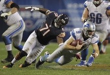 Nam Y. Huh | The Associated Press Chicago Bears defensive end Israel Idonije (71) sacks Detroit Lions quarterback Matthew Stafford (9) in the second half of an NFL football game in Chicago, Monday, Oct. 22, 2012. The Bears won 13-7. (AP Photo/Nam Y. Huh)