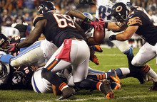 Detroit Lions running back Joique Bell fumbles near the goal line against the Chicago Bears in the second half of an NFL football game in Chicago, Monday, Oct. 22, 2012. Bears' Brian Urlacher, right, recovered the fumble. (AP Photo/Charles Rex Arbogast)