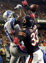 Chicago Bears cornerback Charles Tillman (33) breaks up a pass intended for Detroit Lions wide receiver Calvin Johnson (81) in the second half of an NFL football game in Chicago, Monday, Oct. 22, 2012. (AP Photo/Charles Rex Arbogast)