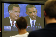 A group of Tulane University students watch the third presidential debate at Tulane University in New Orleans, on Monday, Oct. 22, 2012. Tulane's Political Science department sponsored the event. (AP Photo/Rusty Costanza)
