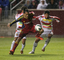 Steve Griffin | The Salt Lake Tribune   Real Salt Lake's Fabian Espindola gets past the C.S. Herediano defense during first half action of the their CONCACAF match at Rio TInto Stadium in Sandy, Utah Tuesday October 23, 2012.
