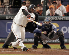 San Francisco Giants' Pablo Sandoval hits a two run home run during the third inning of Game 1 of baseball's World Series against the Detroit Tigers Wednesday, Oct. 24, 2012, in San Francisco. (AP Photo/Charlie Riedel)