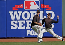San Francisco Giants' Jeremy Affeldt, right, and Javier Lopez warm up before baseball's World Series against the Detroit Tigers Wednesday, Oct. 24, 2012, in San Francisco. (AP Photo/Marcio Jose Sanchez)