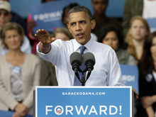 President Barack Obama gestures while speaking to supporters during a campaign stop at The Mississippi Valley Fairgrounds, Wednesday, Oct. 24, 2012, in Davenport, Iowa. The President is on a two day campaign trip across six battleground states. (AP Photo/Charlie Neibergall)