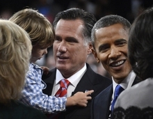President Barack Obama and Republican presidential nominee Mitt Romney meet family members after  the third presidential debate at Lynn University, Monday, Oct. 22, 2012, in Boca Raton, Fla. (AP Photo/Pool-Michael Reynolds)