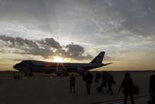 Members of the press pool board the silhouetted Air Force One before President Barack Obama, Wednesday, Oct. 24, 2012, at Andrews Air Force Base, Md. The president was to began a two-day non-stop campaign blitz, through eight states with stops in key battleground areas of Colorado, Nevada, Ohio and Virginia. ( AP Photo/Jose Luis Magana)