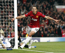 Manchester United's Javier Hernandez celebrates scoring during their Champions League Group H soccer match against SC Braga at Old Trafford in Manchester, England, Tuesday Oct. 23, 2012. (AP Photo/Jon Super)