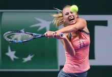 Maria Sharapova of Russia returns a shot to Sara Errani of Italy during their tennis match at the WTA championship in Istanbul, Turkey, Tuesday, Oct. 23, 2012. (AP Photo)