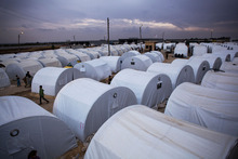 Overview of a refugee camp where almost 6000 Syrians, displaced because of the civil conflict, are living near Azaz, Syria, Tuesday, Oct. 23, 2012. (AP Photo/ Manu Brabo)
