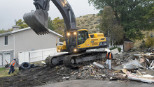Al Hartmann  |  The Salt Lake Tribune Backhoe finishes knocking down a house on Springhill Drive in North Salt Lake on Tuesday, Oct. 23 while the house at left will remain.   With the help of a federal grant, North Salt Lake is stabilizing the Springhill landslide by demolishing homes in the area, shoring up others and and turning the site into an open-space park.