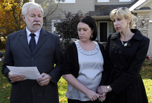 FILE - In this Oct. 9, 2012, file photo George Cary speaks at his home in Howell, Mich., with his daughters Heather Andrus, 33, center, of Howell, and Jill Bloser, 43, right, of Charleston, S.C. Carry, whose wife died in a national outbreak of meningitis, said Wednesday, Oct. 24, 2012, he's in a hospital being treated for the same illness. (AP Photo/Paul Sancya, File)