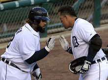 Detroit Tigers' Miguel Cabrera, right, and Prince Fielder celebrate after Cabrera's two-run home run in the fourth inning during Game 4 of the American League championship series against the New York Yankees Thursday, Oct. 18, 2012, in Detroit. (AP Photo/Carlos Osorio)