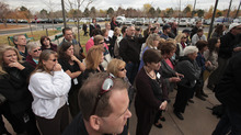 A crowd, mainly consisting of employees from Westminster City Hall, listen as Westminster Police Chief Lee Birk and Jefferson County District Attorney Scott Storey announce the arrest of Austin Reed Sigg,17, for the murder of Jessica Ridgeway at the Westminster Police Station Wednesday, Oct. 24, 2012 in Westminster, Colo. (AP Photo/Barry Gutierrez)