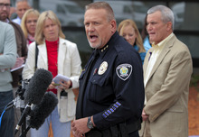 Westminster Police Chief Lee Birk, center, and Jefferson County District Attorney Scott Storey, right, announce the arrest of Austin Reed Sigg,17, for the murder of Jessica Ridgeway at the Westminster Police Station Wednesday, Oct. 24, 2012 in Westminster CO.. (AP Photo/Barry Gutierrez)