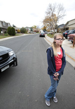 Brooke Olds, 13, stands on the street where she would play frequently, see or talk to Austin Reed Sigg who she knew since she was four years old.
