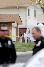 Investigators remove items from what is believed to be Austin Reed Sigg's home at 10622 102nd Avenue Wednesday, Oct. 24, 2012 in Westminster, Colo. Sigg is being held for the murder of Jessica Ridgeway. (AP Photo/Barry Gutierrez)