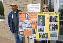 Paul Fraughton | The Salt Lake Tribune Ed DeWolf and Babe DeWolf, with posters expressing their views, stand outside the Spanish Fork Courthouse before the sentencing of Roberto Roman. Roman was acquitted of the murder of Millard County Deputy Josie Fox, but was found guilty of tampering with evidence and possession of a dangerous weapon by a restricted person.  Wednesday, October 24, 2012