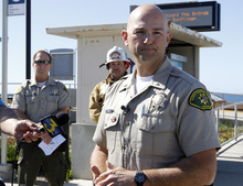 Lt. Eric Raney, of the Santa Barbara Country Sheriffs Department, speaks to the media about the shark attack that killed 39-year-old Francisco Javier Solorio Jr., of Orcutt, Tuesday, Oct. 23, 2012, at Surf Beach in Lompoc, Calif. (AP Photo/The Santa Maria Times, Leah Thompson)